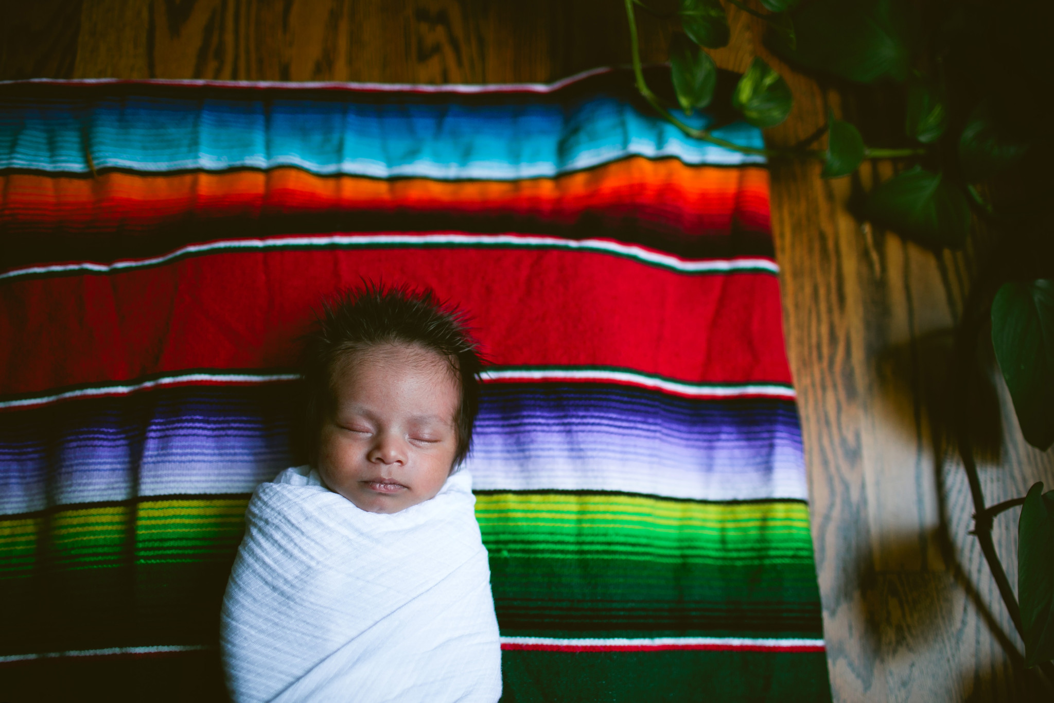 baby on colorful blanket